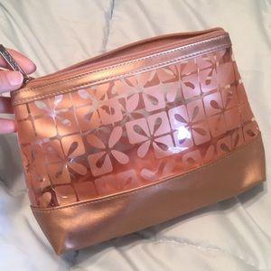 Clinique cosmetic zipper bag /copper metallic
